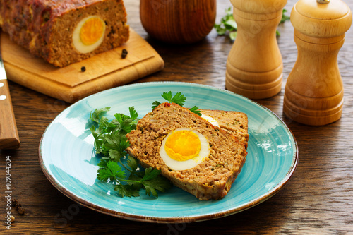 Poster Baked meat loaf with eggs for Easter holiday.