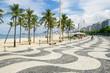 Quadro The iconic sidewalk tile pattern of Copacabana Beach curving off into the Rio de Janeiro, Brazil skyline
