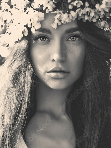 Romantic lady in a wreath of apple trees - 109865645