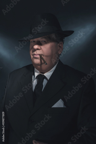 Poster Retro 1930s gangster smoking cigar. Classic studio portrait.