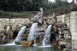 dolphin fountain in the park of royal palace of Caserta Italy