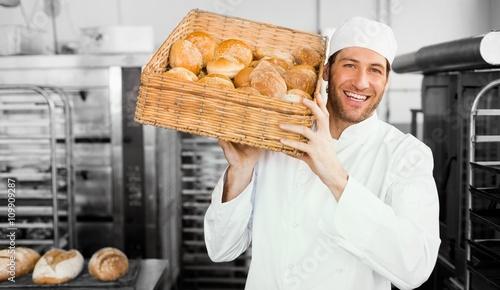 Papiers peints Table preparee Baker holding basket of bread