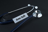 Medical Concept-World health Day words written on label tag with Stethoscope.