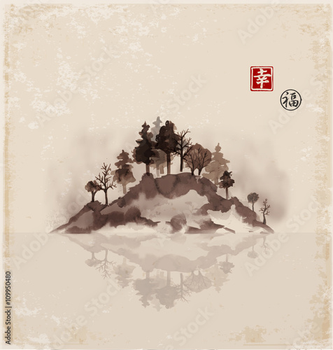 Island with trees in fog