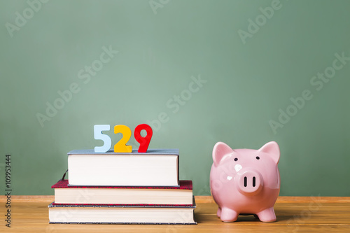 529 college savings plan theme with textbooks and piggy bank Poster