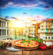 Rustic pizza with old city Italy background