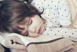 Small child peacefully sleeps close up