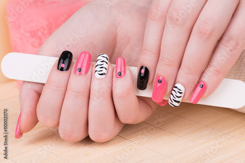 Manicure - Beautifully manicured woman fingernails. Feminine nail art with interesting animal print nail art. © tamara83