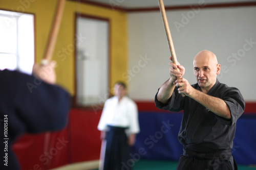 Poster Attack and defense; men practicing sword technique