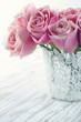 Pink roses in a white lace vase