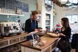 Female Customer Paying In Coffee Shop - 110061410