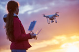 Fototapety drone quadcopter flying at sunset