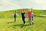 group of happy kids running outdoors