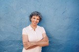 Portrait of attractive mature woman on blue background