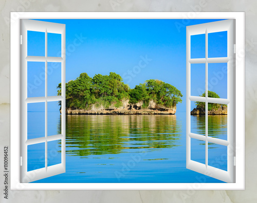 Fototapeta Ocean view from the window on the island of sunny summer day