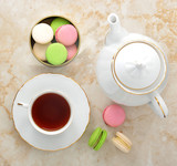 morning tea - tea mug with tea and macarons