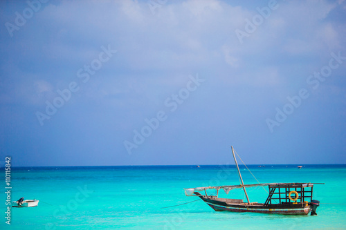 Papiers peints Zanzibar Old wooden dhow at the sea in the Indian Ocean