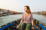 Woman tourist on floating market in Vietnam