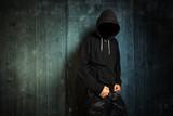 Dangerous unrecognizable faceless criminal standing in front of
