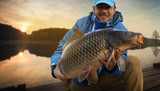 """Happy angler with carp fishing trophy 110175199,newborn baby clothes on textile background"""""""