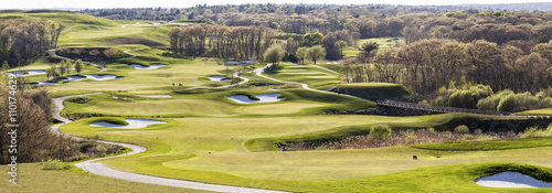 Fototapeta Panoramic view of a Well-groomed golf course.