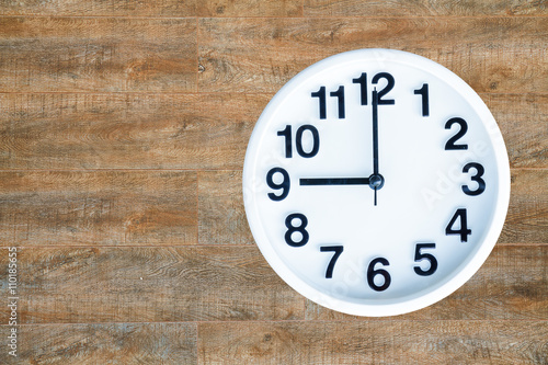 Poster Clock on wood background