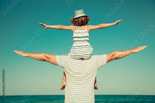 Father and child having fun on the beach