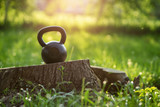 Outdoor photo from a kettlebell in a park, sunset in the background