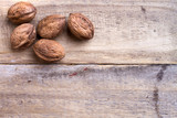 five walnuts on wooden table