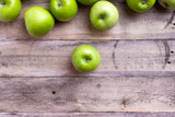 green apples on wood