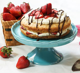 Strawberry Shortcake with fresh strawberries whipped frosting and chocolate drizzle
