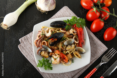 Poster Italian pasta with seafood, mussels, clams, shrimp and squid