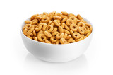 Bowl with corn rings isolated on white background. Cereals.
