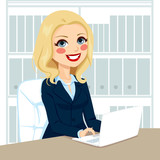 Successful senior businesswoman working typing on laptop on her desk at office