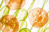 art background from sliced cucumber and tomato