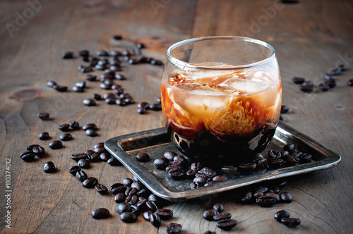 Poster Kahlua liqueur with cream in glasses with coffee beans on a wooden background, s
