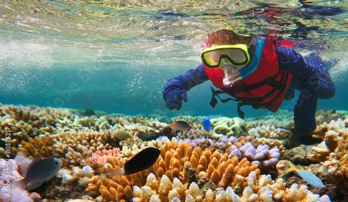Child snorkeling in Great Barrier Reef Queensland Australia