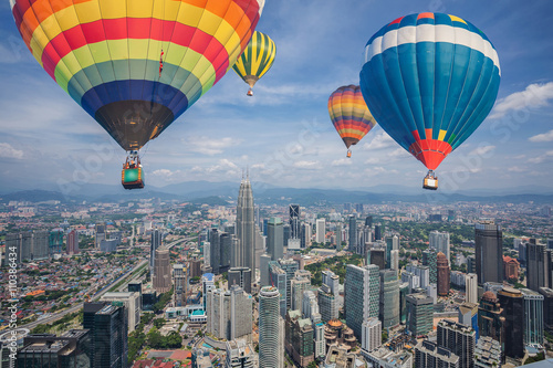 Plakát Balloon fly over Kuala Lumpur city skyline and skyscrapers