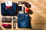 Casual outfit and accessories of businessman on wooden table