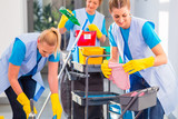 Commercial cleaners doing the job together - 110402874