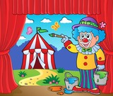 Clown painting image of circus on stage