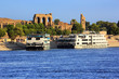 Egypt. Cruise ships docked at Kom Ombo on the Nile. The Temple of Sobek and Haroeris - seen colonnade of the Hypostyle Hall
