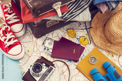 Holiday suitcase on wooden table