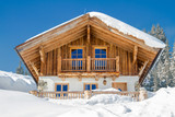 Mountain chalet in the alps in winter - 110500473