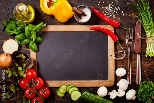 Chalkboard Surrounded by Herbs and Vegetables