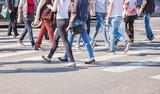 pedestrians walking on a crosswalk - 110510447