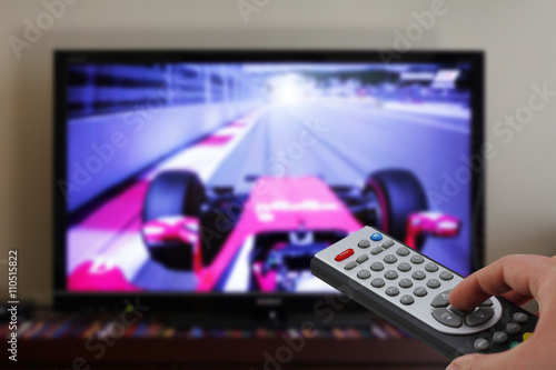Poster Tv remote control in a car race