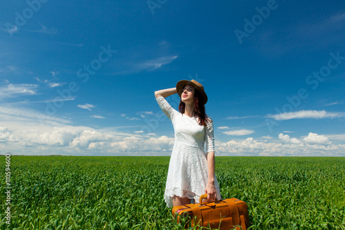 young woman with suitcase Poster