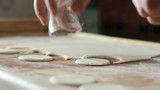 Chef cuts dough into shapes