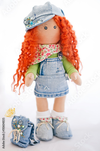 Zdjęcia Red-haired doll handmade dressed in jeans